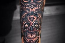 22 a black owl and a skull inside it
