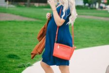 22 a teal dress, orange sandals and a red bag