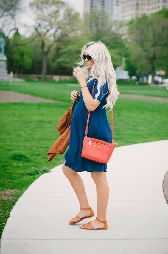 a teal dress, orange sandals and a red bag