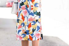 22 bold floral skirt, a striped long sleeve and black heels