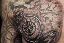 22 half shoulder and half breast map tattoo with a compass