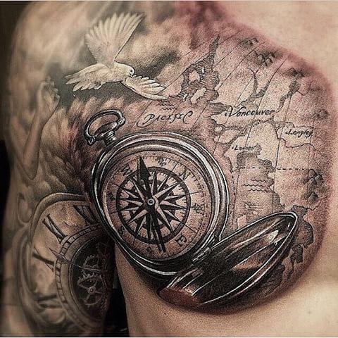half shoulder and half breast map tattoo with a compass
