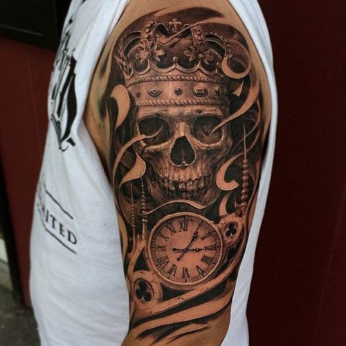 tribal skull tattoo with a clock on an arm