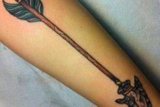 Arrow tattoo with green color