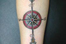 Arrow with compass tattoo