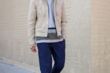 Beige jacket with striped shirt, navy blue pants and white sneakers