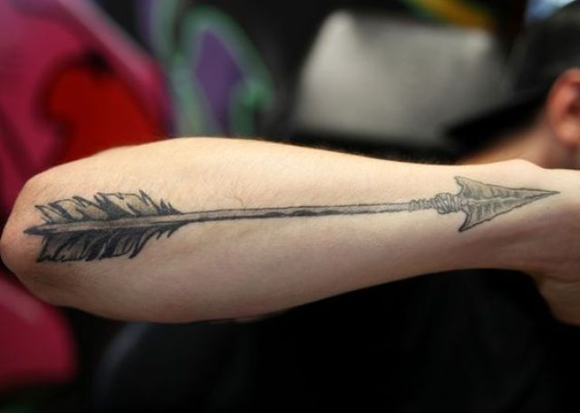 Big arrow tattoo