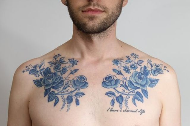 Blue flowers tattoos on the chest