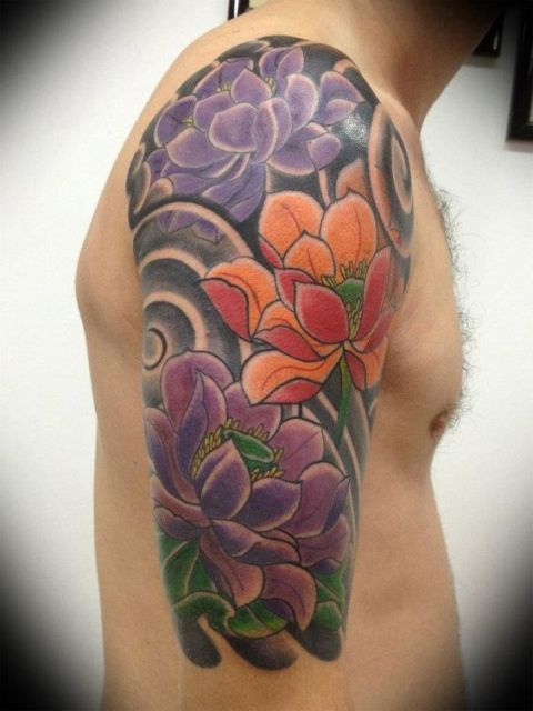 Colorful half-sleeve floral tattoo