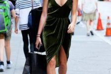 Emerald dress with black ankle boots and sunglasses