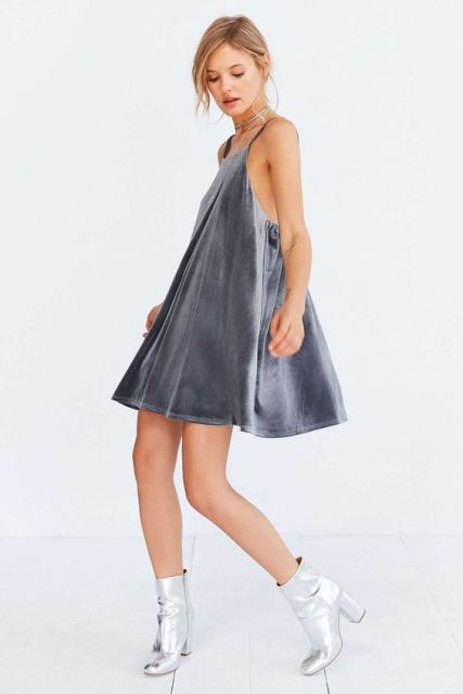 Gray dress with metallic boots and necklace