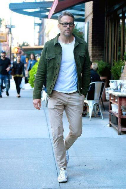 Green jacket with white t shirt and beige pants
