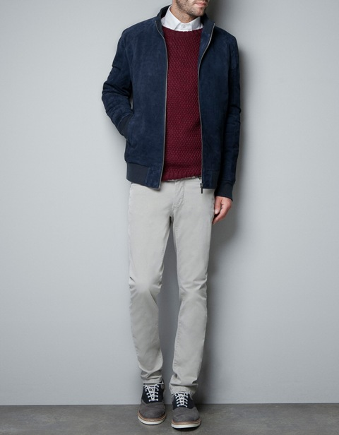 Navy blue jacket with marsala sweater and white pants
