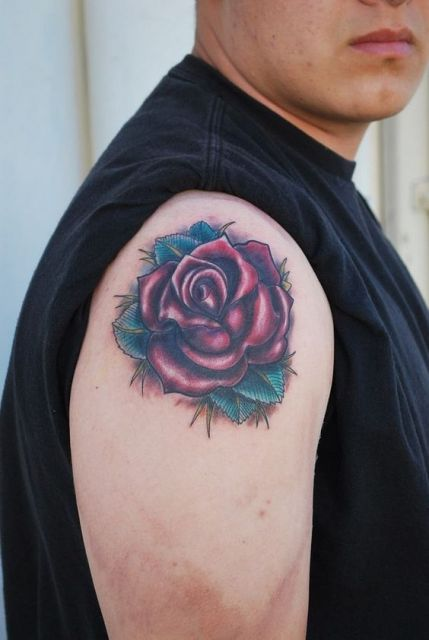 Red rose with green leaves on the shoulder