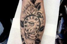 Roses with clock tattoo on the arm