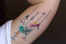 Several colorful tattoos on the left arm