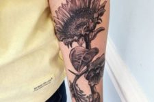 Sunflower tattoo on the arm
