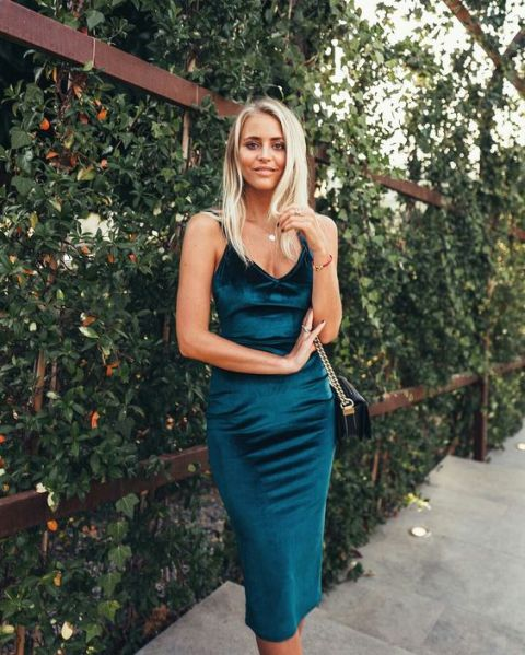 Teal dress with black chain strap bag