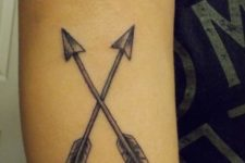 Two crossed arrows tattoo