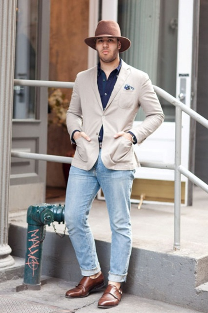 With beige blazer, light blue jeans and hat