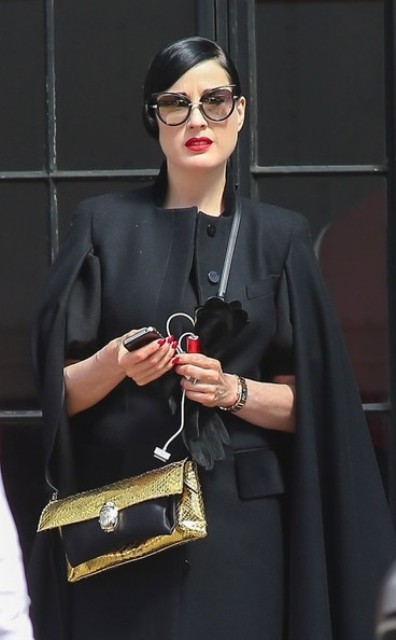With black coat, black gloves and sunglasses