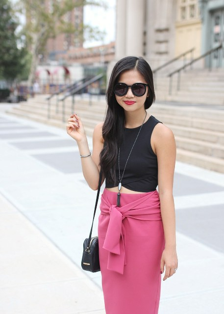 With black crop top and mini bag