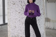 With black jeans and purple turtleneck