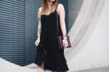 With black midi dress and colored bag