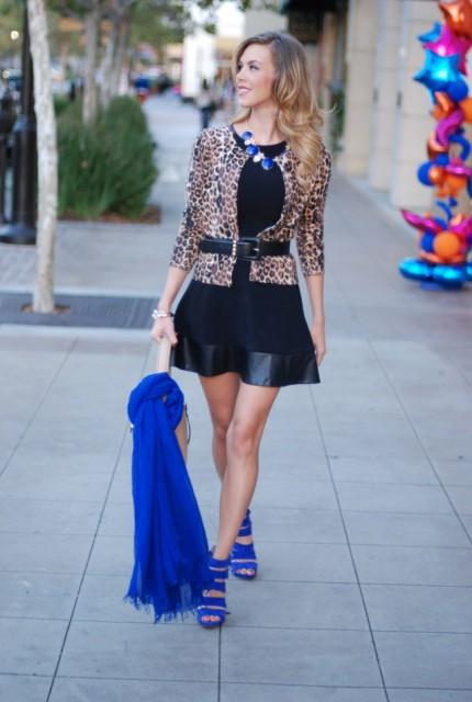 With black mini dress, leopard jacket and black belt