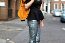 With black peplum blouse, orange jacket and sneakers