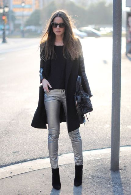 With black shirt, ankle boots, coat and leather bag