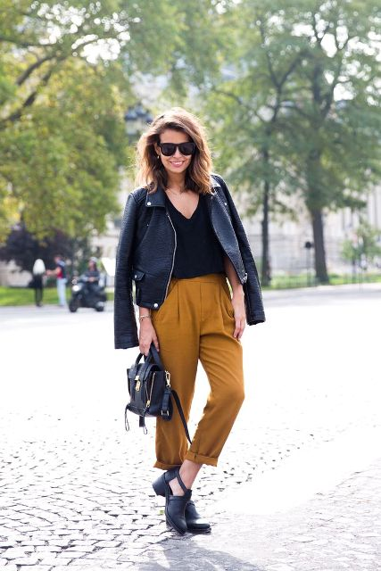 With black shirt, high-waisted pants and leather jacket