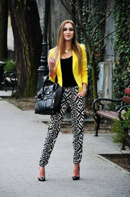 With black shirt, printed trousers and black heels