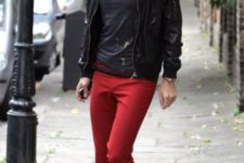 With black t-shirt, black leather jacket and metallic boots