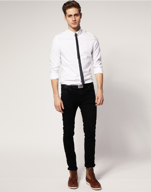 With black tie, white shirt and brown boots