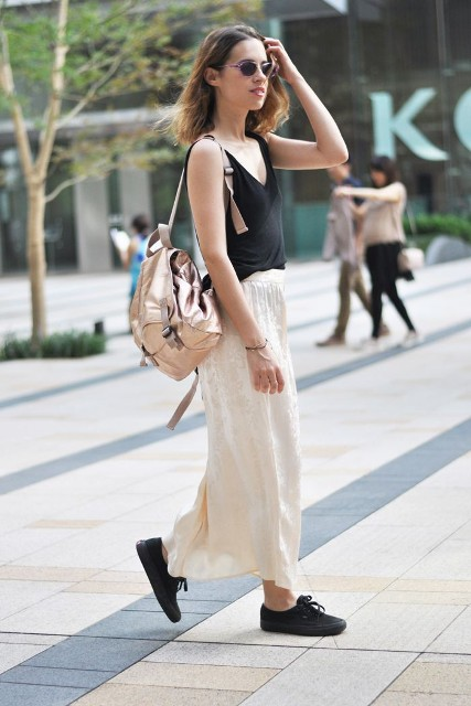 With black top, maxi skirt and black shoes