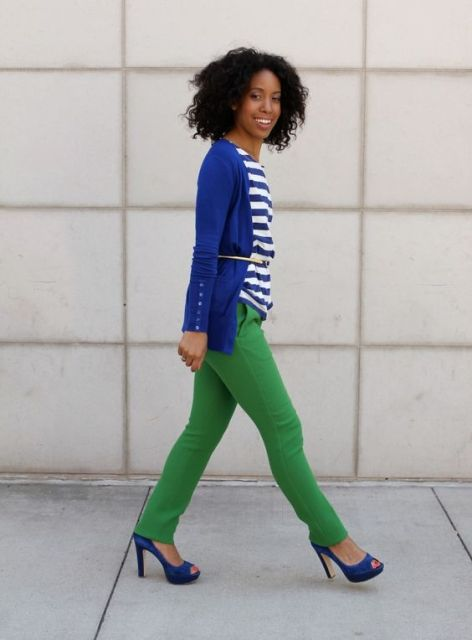 With blue blazer, green skinny pants and printed shirt