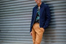 With blue jacket, light brown pants and white sneakers