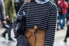 With blue shirt, striped shirt and black clutch