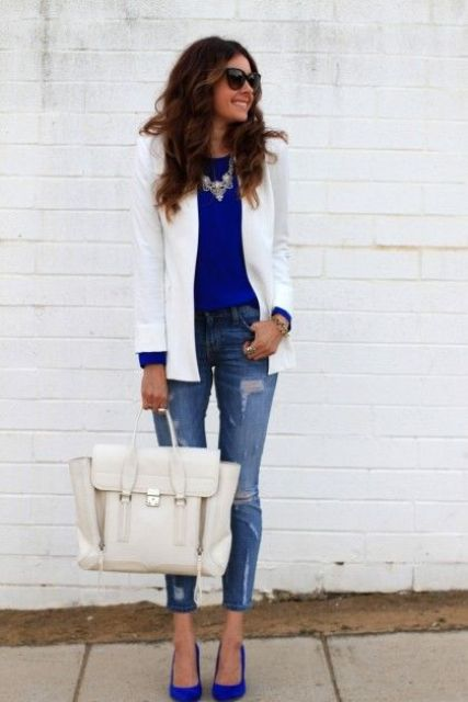 With blue shirt, white blazer, distressed jeans and white bag