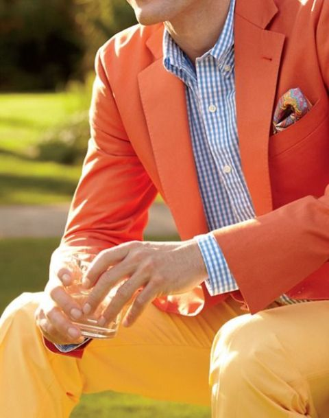 With checked shirt and orange blazer