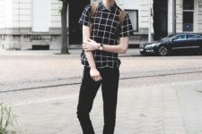 With checked shirt, brown backpack and beige shoes
