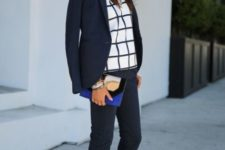 With checked shirt, pants, navy blue jacket and clutch