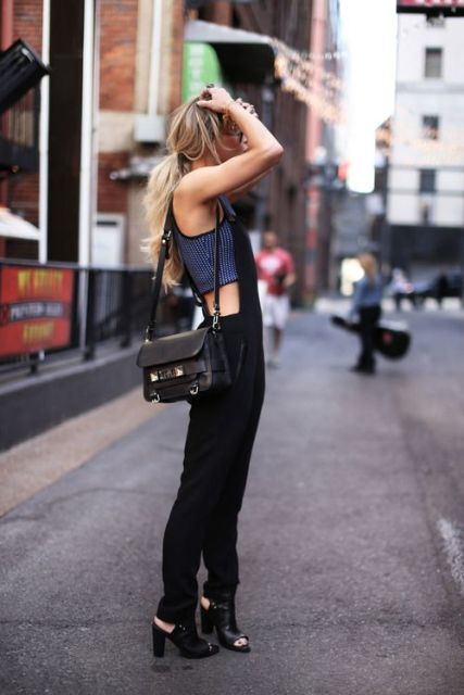 With crop top, black overall and black bag