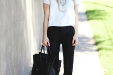 With crop white shirt, black pants and leather bag