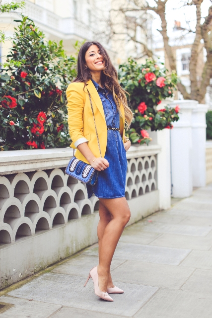 With denim dress, beige shoes and printed bag