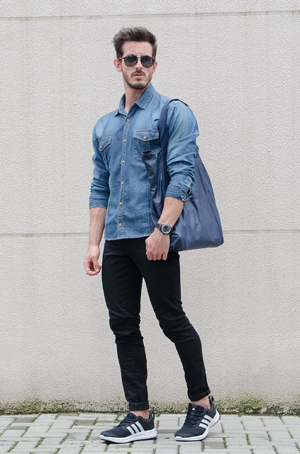 With denim shirt, blue bag and sneakers