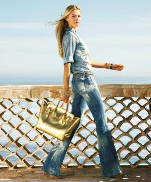 With denim shirt, flare jeans and brown shoes