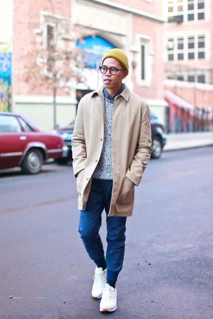 With denim shirt, gray sweater, beige coat, yellow hat and white sneakers