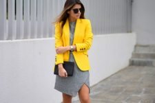With gray dress, gray shoes and black clutch